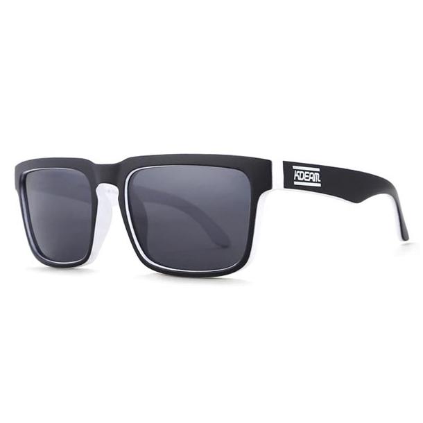 #S52 Lækker surfet solbrille med HVID OG SORT stel - Polaroid glas