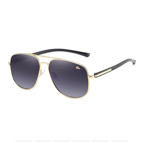 #S85 Lækker klassisk pilot solbrille fra Lacoste med UV400 filter og polaroid-glas.